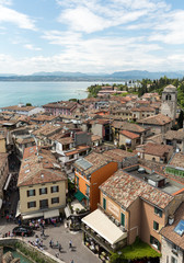 View of colorful old buildings in Sirmione and Lake Garda from Scaliger castle wall, Italy