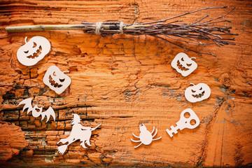 halloween decoration on orange wooden background