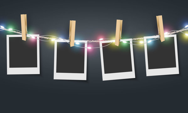 Blank photo frame hanging on rope with colorful fairy lights Vector