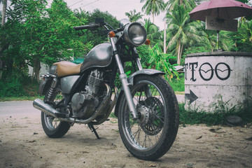 Freedom.Motorbike on tropical road,vintage effect create for atmosphere