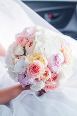 Bride's bouquet in her hands