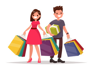 Happy family couple with shopping. Man and woman with bags. Big