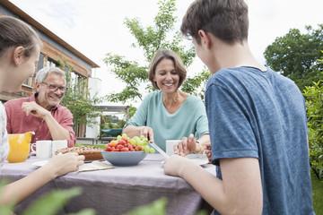 Happy family in garden having afternoon break
