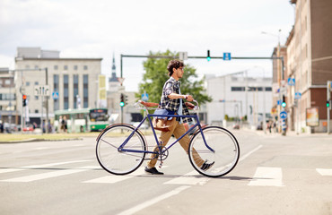young man with fixed gear bicycle on crosswalk