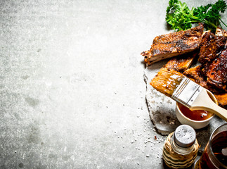 Smoked barbecue ribs with beer and herbs.