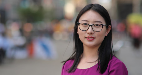 Young Asian woman in city face portrait