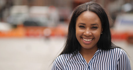 Young black woman in city smile happy face portrait