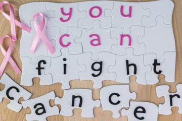 Copmlete puzzle with fight cancer inspirational quote about brea