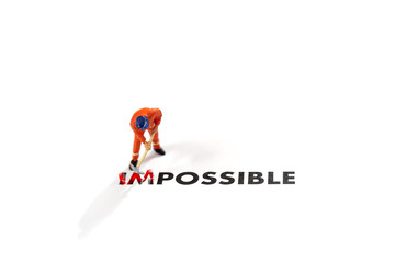 Worker digging and business man looking to him with the text impossible, digging the word im so it written possible. success and challenge concept.