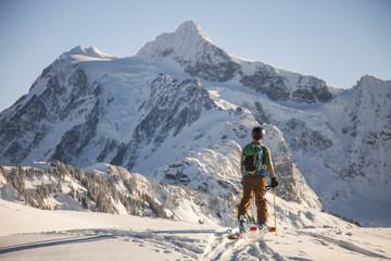 A skier crosses a snowfield.