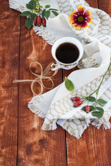 cup of coffee and autumn flowers on a wooden table