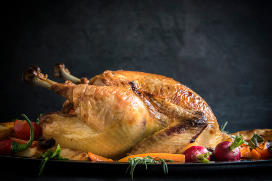 Served roasted turkey with vegetables