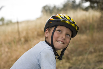 Boy wearing cycle helmet