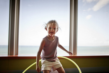 Portrait of young girl with hula hoop.