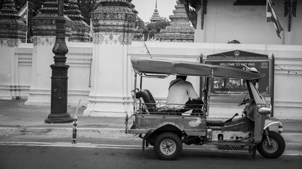 Tuk Tuk taxi waiting customers on street at Wat Phra Chetupon Vimolmangklararm (Wat Pho) temple in Thailand/ Black and white style image of