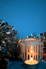 Christmas candle light/Decorational christmas candle light with shiny decoration ornaments on blue backround