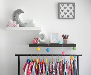 Decorative shelves on wall as detail of kid room interior