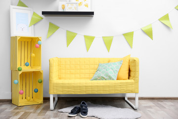 Modern interior design with yellow sofa