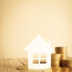 house model and row of coin money and free space for finance and banking concept