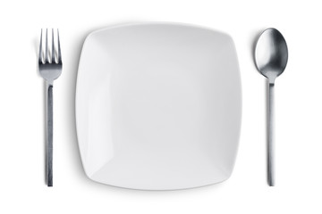 White plate with silver fork and spoon with clipping path