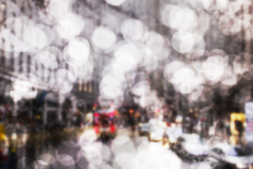 bokeh art background of road traffic in London on a rainy day through the bus window. raindrops on the glass window of the bus Wall mural