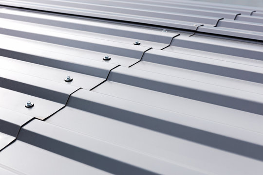 gray corrugated metal cladding on industrial building roof