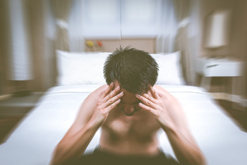 unhappy, insomnia & worried asian handsome man thinking about his problem in bedroom all night