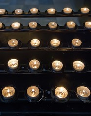 Candles lit in catholic temple