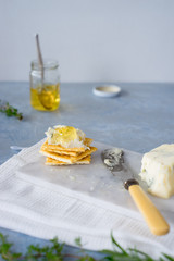 Crackers with gorgonzola and herb and white wine  jelly. Selective focus.