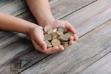 Boy hands holding money coins