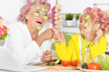Senior woman and granddaughter at kitchen