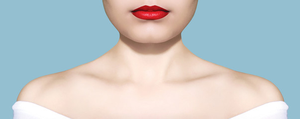 Beauty woman portrait white skin and red lips closeup over blue