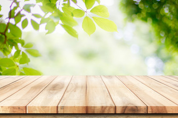 Empty wooden table with garden bokeh background with a country outdoor theme,Template mock up for display of product Wall mural