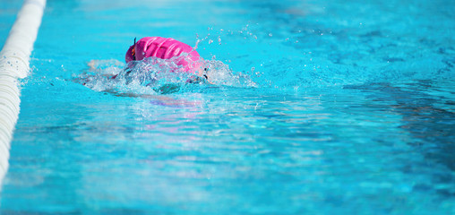 Woman swimming the front crawl in a pool