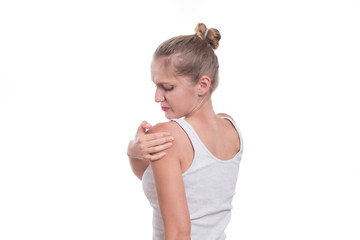 Acute pain in a woman shoulder. Female holding shoulder