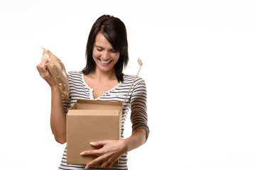 Happy woman with open cardboard box