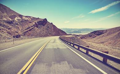 Retro stylized desert road, travel concept.