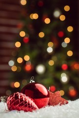 Composite image of red baubles and decorations