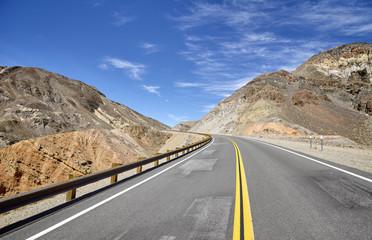 Empty highway in mountainous terrain, travel concept.