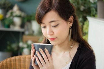 Portrait of thai adult women office beautiful girl drinking coffee