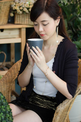Portrait of thai adult women office beautiful girl drinking coffee