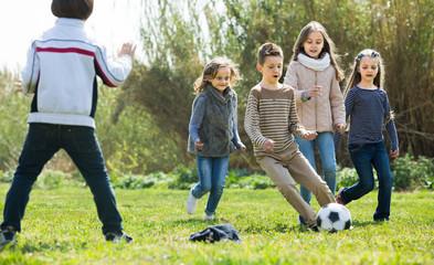 children running after ball