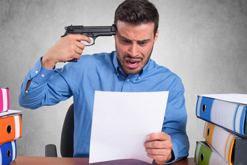Businessman pointing a gun to his head