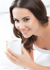 woman drinking coffee or tea, at home