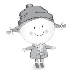 Little girl standing in winter clothes and smiling