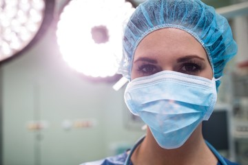 Portrait of surgeon wearing surgical mask in operation room
