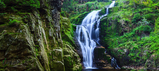 Panorama of Kamienczyk Waterfall in Karkonosze National Park in Poland Sudety Mountains near Szklarska Poreba town.