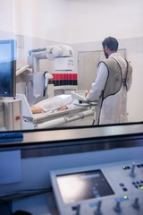 Doctor using x-ray machine to examine patient