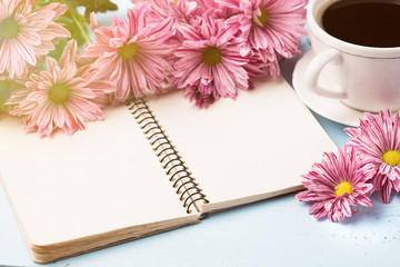 Cup of black coffee, Bouquet of flowers and Empty paper sheet