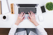 Businesswoman typing on keypad topview
